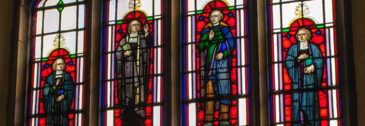 4 stained glass windows with saints